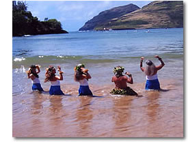 Halau members greet competitors in the Kaua`i World Challenge Canoe Race in Kalapaki